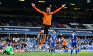 Jed Wallace celebrates after Jon Dadi Bodvarsson's goal sealed victory for Wolves at St Andrews.