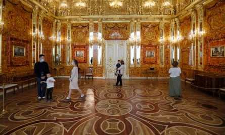 People visit the replica Amber Room at the Catherine Palace near St Petersburg