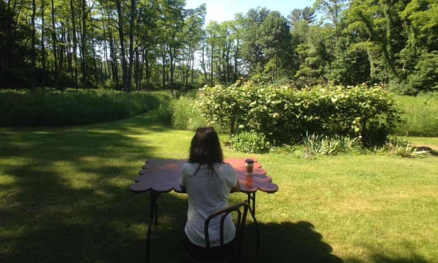Single Woman Outdoors, Sitting At A Table
