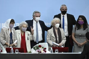 Argentina's President Alberto Fernandez poses with (L to R) Taty Almeida, of Madres de Plaza de Mayo; Lita Boitano, president of Relatives of the Disappeared and Detained for Political Reasons; Estela de Carlotto, president of Abuelas de Plaza de Mayo; Human Rights secretary Horacio Pietragalla Cortior; and recovered granddaughter Victoria Montenegro after the ceremony to honor Abuelas and Madres de Plaza de Mayo members