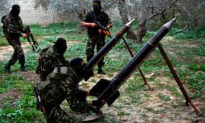 Palestinian Islamic Jihad members in the east of Gaza City on 20 December 2008, preparing al-Quds rockets to be fired into Israel.