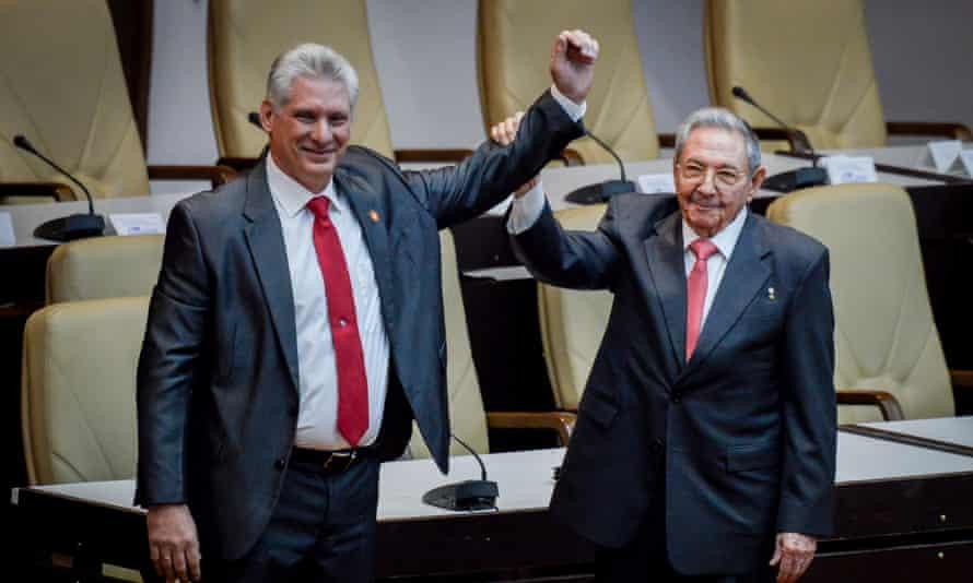 The outgoing Cuban president, Raúl Castro, right, raises the arm of Cuba's new president, Miguel Diaz-Canel.