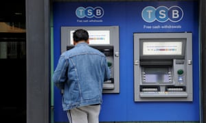 A TSB customer uses an ATM in London