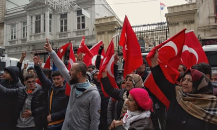 Demonstrators wave Turkish flags outside the Consulate of Netherlands in Istanbul