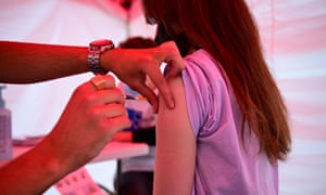 A young person is vaccinated today at an outdoor centre at Republique square in Paris.