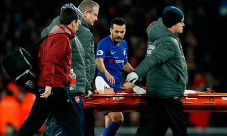 Hector Bellerín is consoled by his compatriot, Chelsea's Pedro, after injuring his knee in Saturday's match at the Emirates.