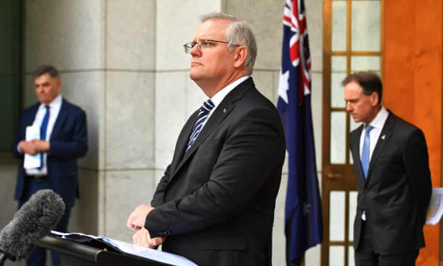 Australian prime minister Scott Morrison at a Covid briefing with health minister Greg Hunt