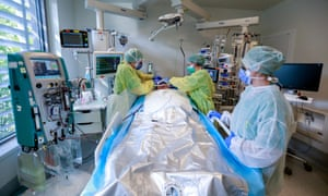 Medical staff caring for a patient with Covid-19 at a hospital's intensive care unit in Brussels.