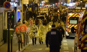 People being evacuated near the Bataclan concert hall in Paris