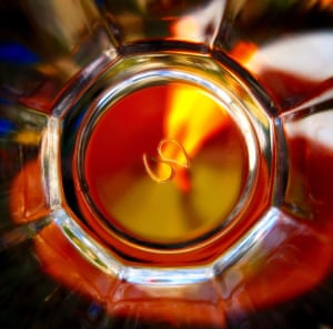 A candle burning in a glassPhotograph: Bairdedoo/GuardianWitness
