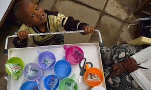 John, 3, who suffers from multi-drug-resistant tubeculosis (MDR-TB), plays with a medicine trolley next to his mother Elizabeth, also an MDR-TB case, at a Medecins Sans Frontieres (MSF)-run clinic in Nairobi, 2015