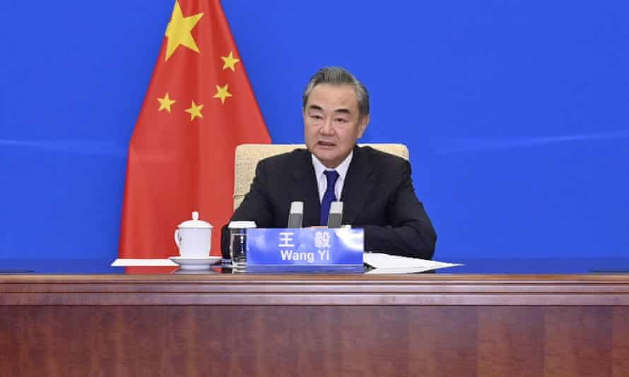 Chinese Foreign Minister Wang Yi meets with US Special Presidential Envoy for Climate John Kerry, not shown, via video link in China. Wang warned Kerry on Wednesday that deteriorating US-China relations could undermine their cooperation on climate change.