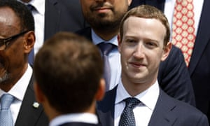 Mark Zuckerberg listens to the French president, Emmanuel Macron, at the Élysée Palace in Paris