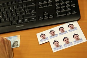 Jan 2017: Pictures of Gabriel lie next to his former identity card as he waits to be issued with a new one