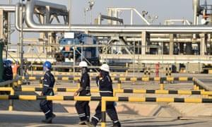 Employees of Aramco oil company in Saudi Arabia's Abqaiq oil processing plant.