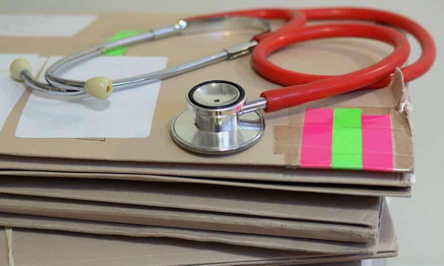 A stethoscope on top of patient files