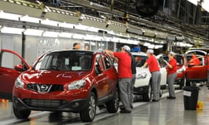 workers complete final checks on the production line at Nissan's car plant in Sunderland.
