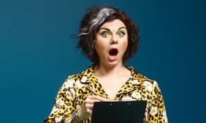 Caitlin Moran holding a clipboard and looking shocked