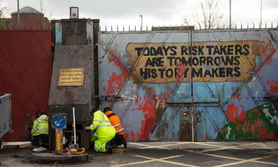 The peace gates in Lanark Way being repaired after violence the night before, Belfast, Northern Ireland, 9 April 2021.