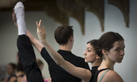 Ballet dancers warm up during a rehearsal in the Bolshoi Theatre