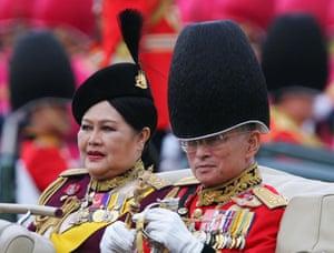 King Bhumibol Adulyadej and Queen Sirikit after reviewing an honour guard in Bangkok, 2005.