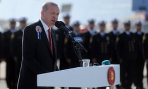 President Recep Tayyip Erdoğan makes a speech on the deck of the TCG Burgazada, a new warship.