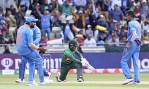Indian cricketers celebrate the dismissal of Bangladesh's Mushfiqur Rahim , centre.