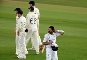 Pakistan's Azhar Ali walks off the pitch after being dismissed by England's James Anderson.