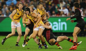 Joe Daniher tackles Ben Griffiths of the Tigers.