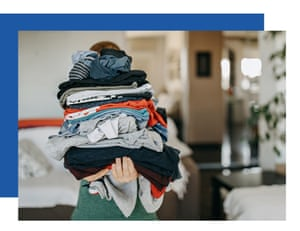Person carrying pile of clean laundry