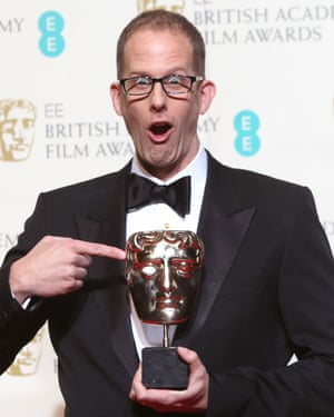 Joyful … Pete Docter with his Bafta for Inside Out.