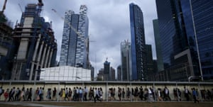 Commuters head home in evening rush hour from Singapore's financial district.