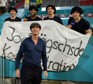 A relieved looking Joachim Löw poses with some of his fans.