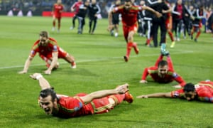 Gareth Bale celebrates with his team-mates after Wales qualified for Euro 2016, despite defeat to Bosnia-Herzegovina.