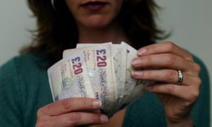 A woman counting money, cash, £20, twenty pound notes