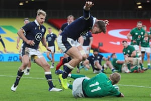 Ireland's wing Keith Earls scores a try.