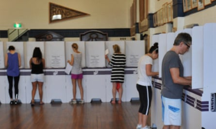 Voters during the federal election. A man has won a legal battle in a NSW court after being prosecuted for failing to vote