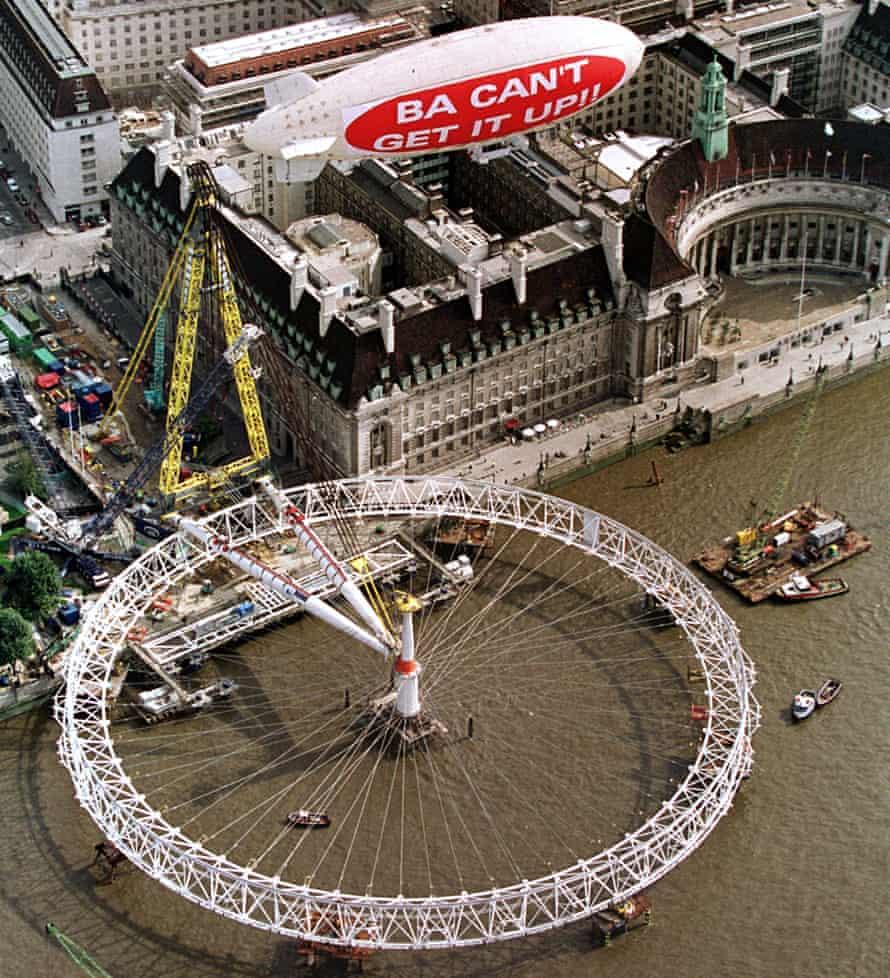 A Virgin airship flies over the London Eye