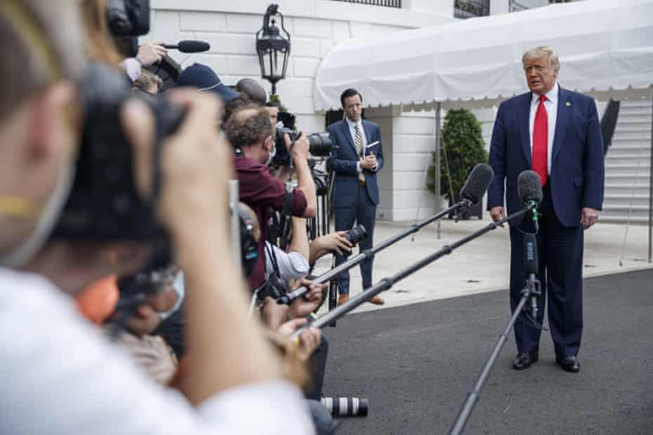 Donald Trump speaks to the media before boarding Marine One on 10 July to head to coronavirus-stricken Florida as he ramps up public appearances ahead of the election.