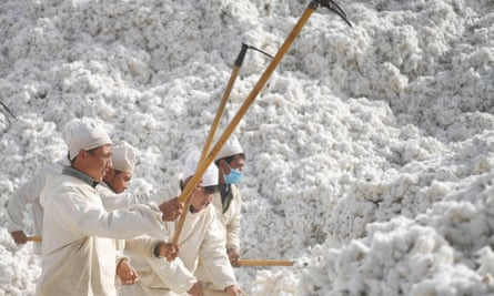 Workers at a cotton factory in Awat county, in China's Xinjiang region.