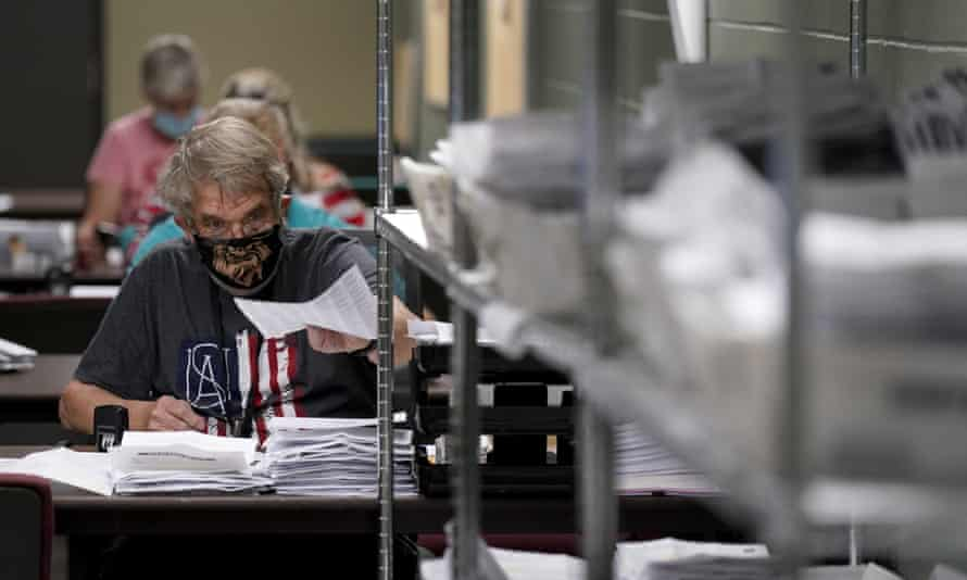 Election worker Kenneth Conkle processes mail-in ballot requests Tuesday in Olathe, Kansas.