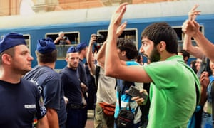 People protest at the railway station in Budapest after police evacuated the station.