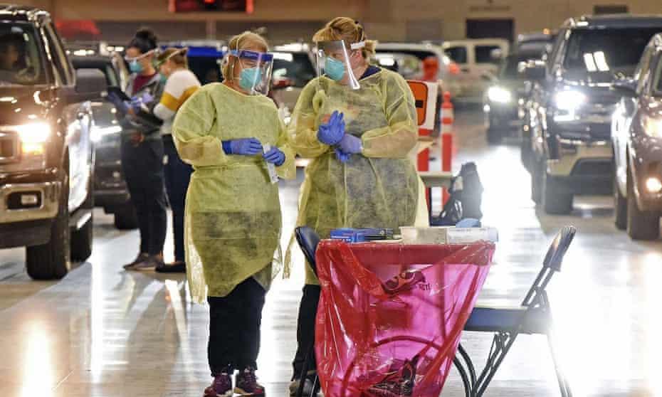 Nurses confer inside the Bismarck Event Center in Bismarck, North Dakota, where vehicles were lined up for Covid-19 tests last month.