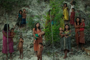 Production still from Tawai showinh women holding small children.