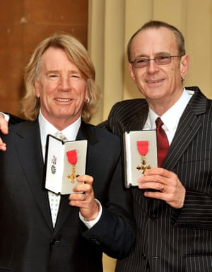 Status Quo founders Rick Parfitt and Francis Rossi with the OBEs awarded to them at Buckingham Palace on 12 February 2010