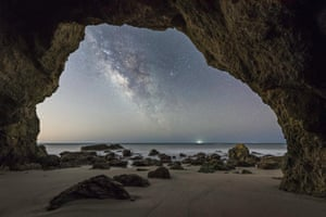 Cave ManBrandon Yoshizawa (USA). Battling the light pollution in Malibu, California, the photographer brilliantly framed our galaxy, the Milky Way, inside a sea cave, 25 miles away from the heart of downtown Los Angeles. The image required two exposures; one to capture the details of the dark cave and one for the Milky Way. Both exposures were taken back to back without moving the camera or changing the composition.