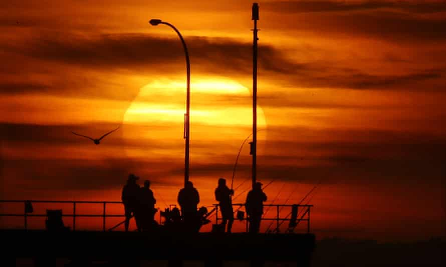 Every Australian state and territory had above average day and night-time temperatures, the Bureau of Meteorology says. Sunrise over Altona pier in Melbourne