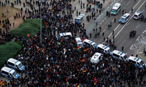 Aerial view of crowds and police vans