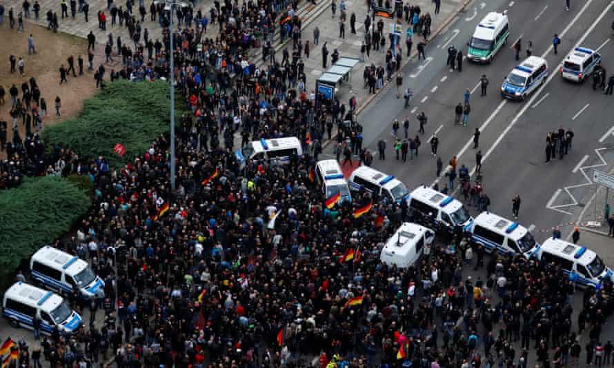 Aerial view of crowds and police vans