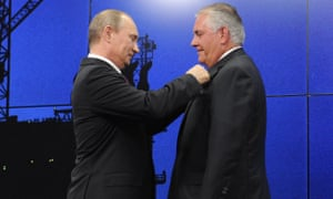 Russia's president Vladimir Putin presents Rex Tillerson with the Order of Friendship at the St Petersburg economic forum in June 2013.